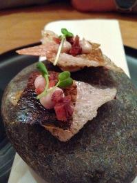 Snack; tapiaco crisp, crispy skin of fish, creme of anchovies, tomato chutney